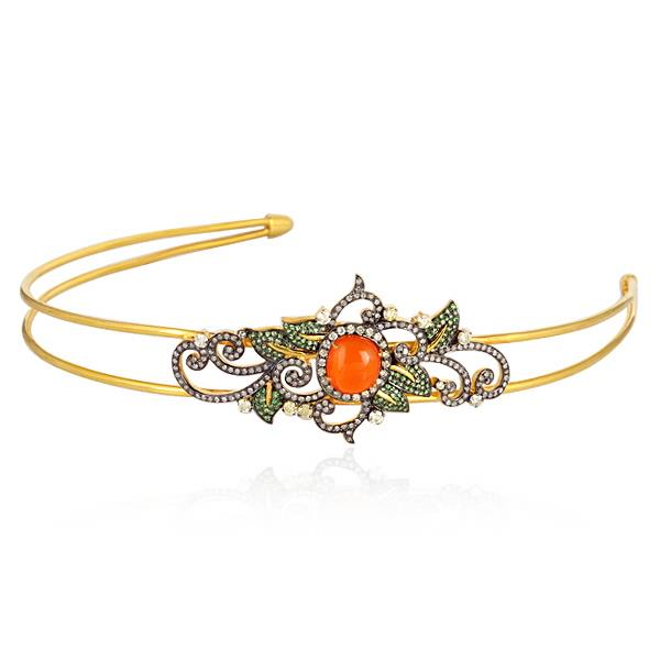 Crown in 18 Kt gold and silver with diamonds and tsavorite.