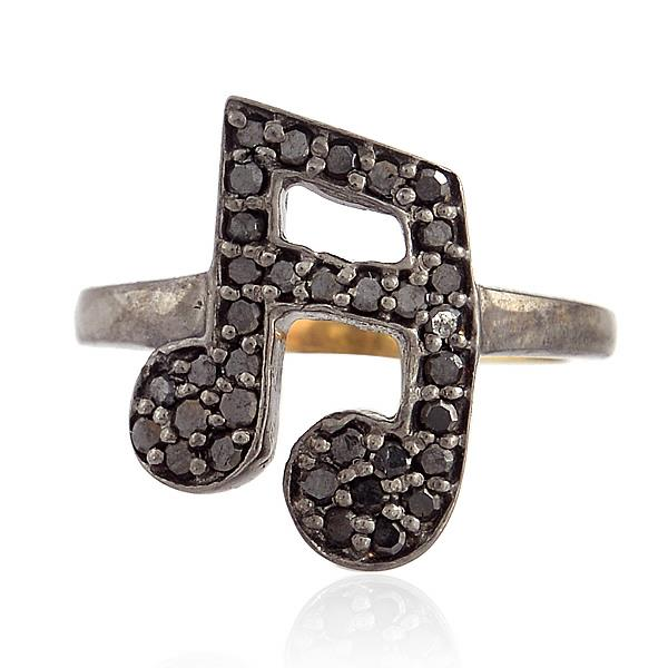 Ring in 18 kt gold and silver with diamonds.