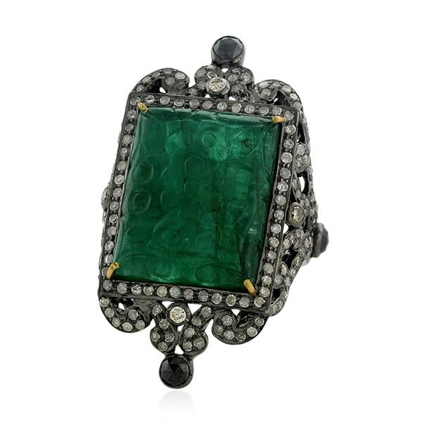 Ring in 18 Kt gold and silver with diamonds and emerald.