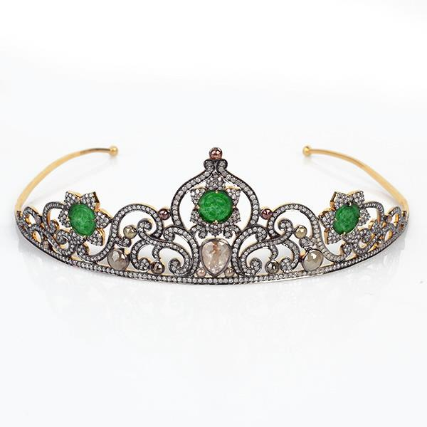 Crown 18 Kt gold and silver with diamonds.